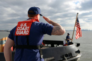 STATEN ISLAND, New York (May 20, 2015) - Storekeeper 3rd Class Tyler Brady, a Coast Guardsman with Coast Guard Sector New York, renders honors to the national ensign during morning colors aboard USCGC Sturgeon Bay (WTGB 109) at USS The Sullivans Pier in Staten Island, New York. Brady and the Sturgeon Bay are participating in Fleet Week New York 2015. Fleet Week New York, now in its 27th year, is the city's time-honored celebration of the sea services. It is an unparalleled opportunity for the citizens of New York and the surrounding tri-state area to meet Sailors, Marines, and Coast Guardsmen, as well as witness firsthand the latest capabilities of today's maritime services. (U.S. Navy photo by Mass Communication Specialist 1st Class Patrick A. Gordon/RELEASED)